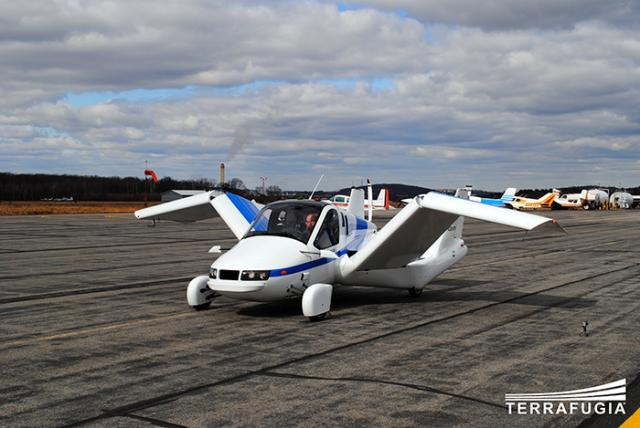 Terrafugia-Transition-Unfold-Planes-Flying-Car-Unveiled-at-Wisconsin-Air-Show.jpg