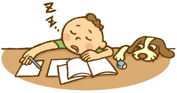 勉強の途中で居眠りしている男の子