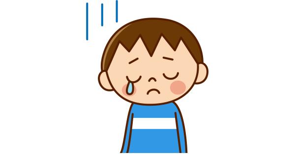 涙を零している男の子