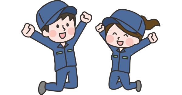 笑顔でジャンプ!作業服の男性と女性