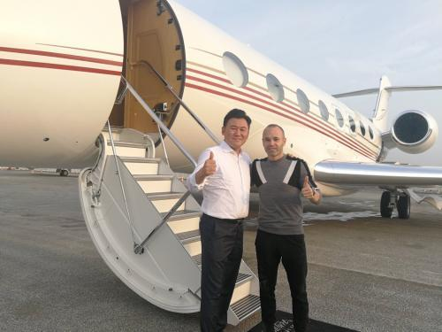 Andres Iniesta on his way to Japan with Rakuten's CEO Hiroshi Mikitani