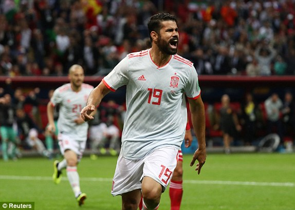 Costa wheels away in celebration after giving Spain the lead