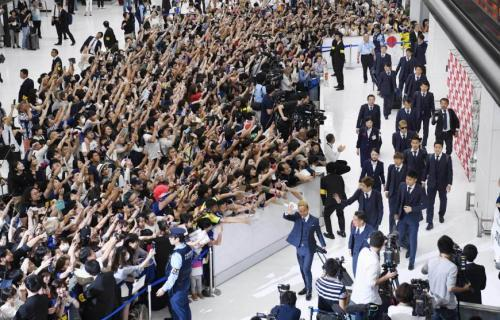 Hundreds of Japan supporters welcomed home their team from the 2018 World Cup