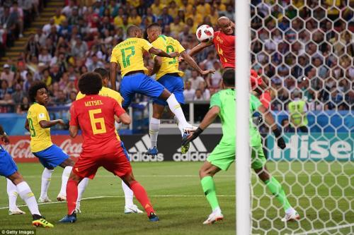 Brazil goalkeeper Alisson falls to the ground as he fails to save the ball from going into Brazils net