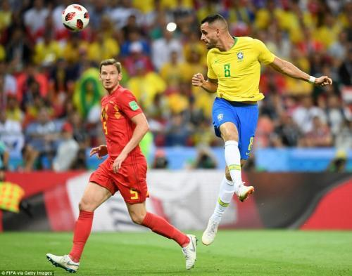Renato Augusto of Brazil guides a header into the Belgium net to pull his side back within a goal